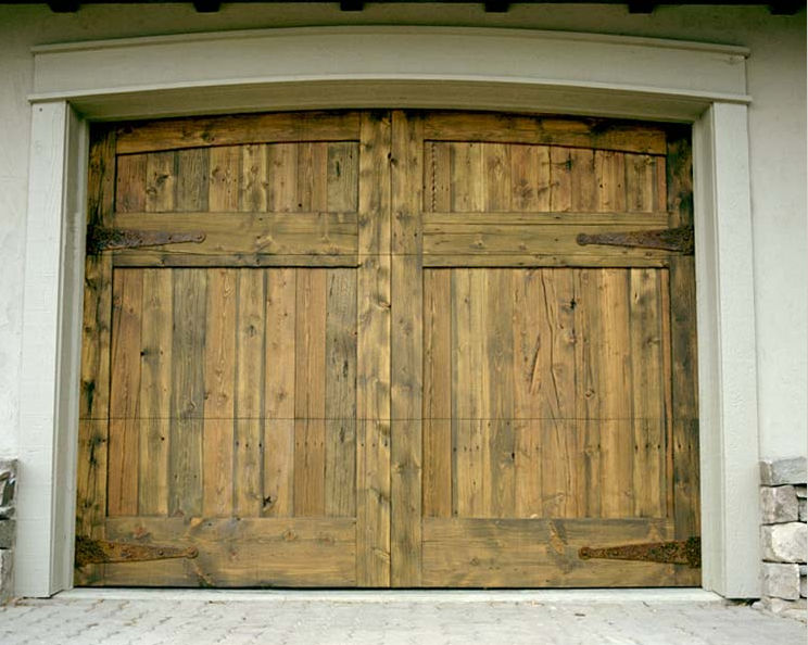 Custom wood garage doors by montana rustics for Rustic wood garage doors